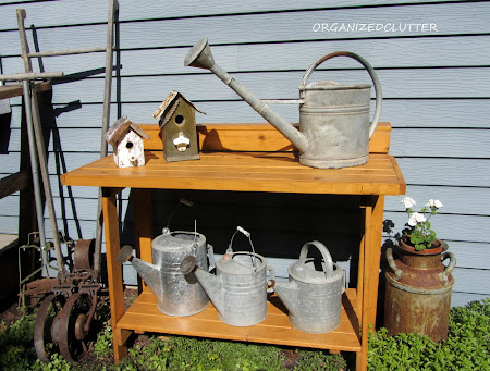 A Folding Workbench to Display Watering Cans