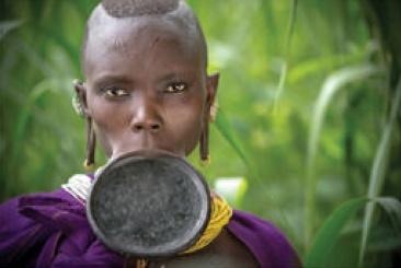 A Suri woman wearing a lip plate
