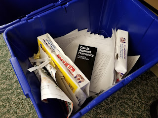 cards against humanity in a recycling bin