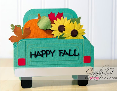 3d card of the back of a pick up truck carring pumpkins and sunflowers