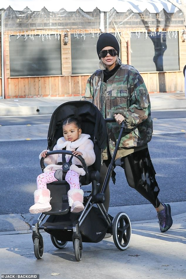 Khloe Kardashian steps out in a camouflage jacket as she visits farmers' market with True