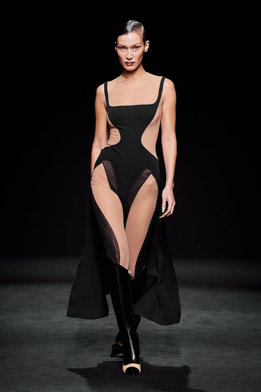 Bella Hadid sizzles in slinky black gown with risqué nude inserts at Mugler Paris Fashion Week show