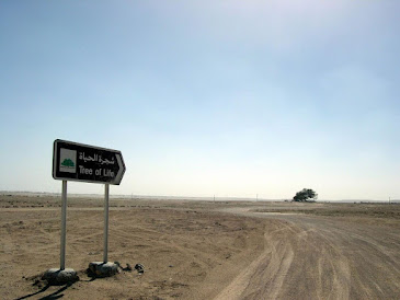 A sign pointing the way to the Tree of Life in the distance.