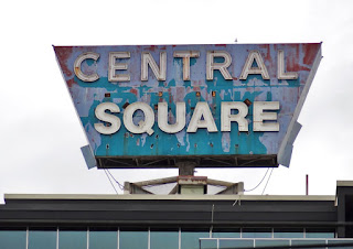 Old roof-top sign with name of office building: Central Square