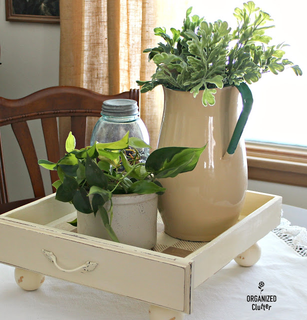 Photo of drawer used as container vignette on a table