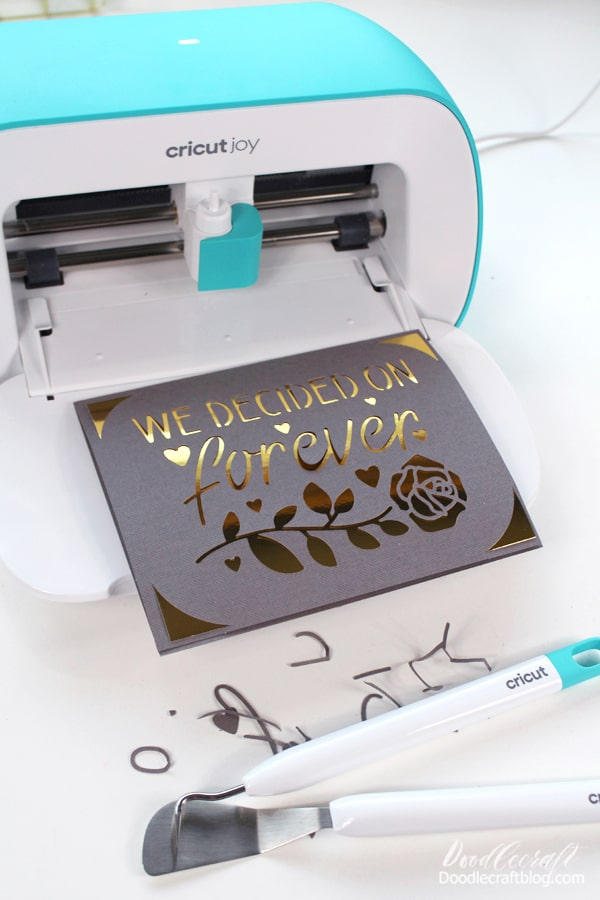 Then remove the card from the mat and use the spatula to remove the cut-outs. Then insert the shiny gold insert into the corner notches
