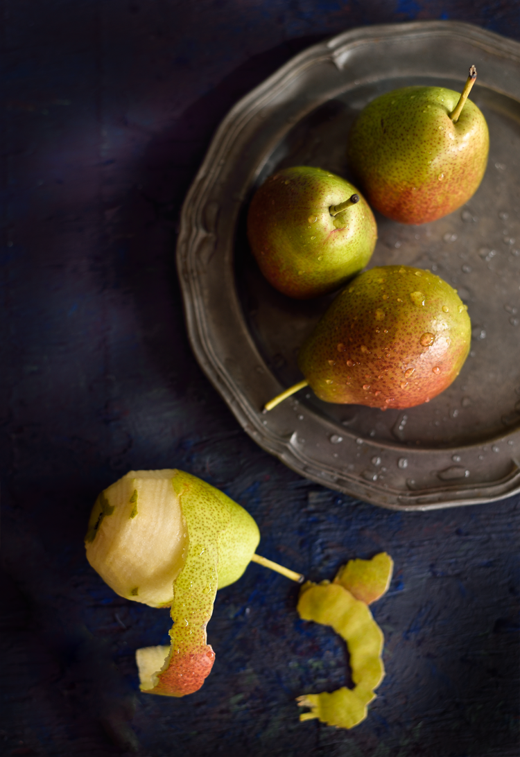 Poached pears with mango sauce