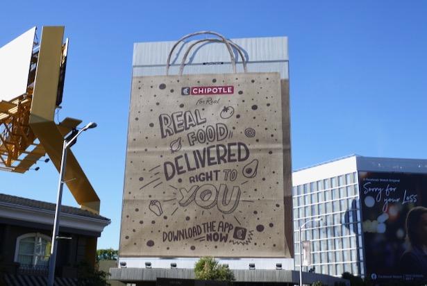 Chipotle food delivery paper bag handles billboard