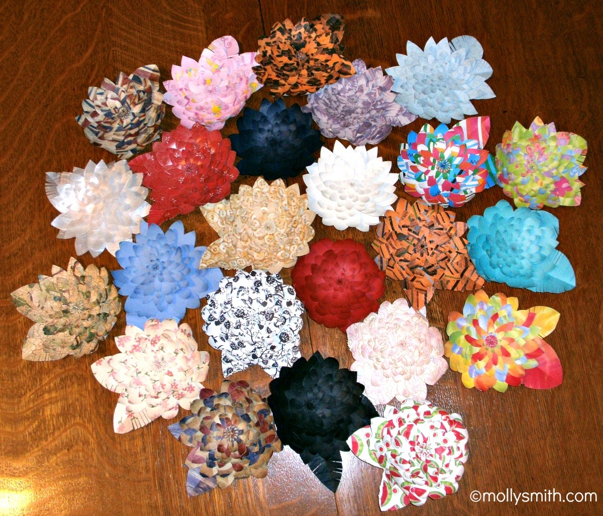Molly smith handmade layered paper flowers these are 4 flowers with 9 10 layers you can make as few as three layers i used them on a background in my booth as an eye catcher to draw people to my mightylinksfo