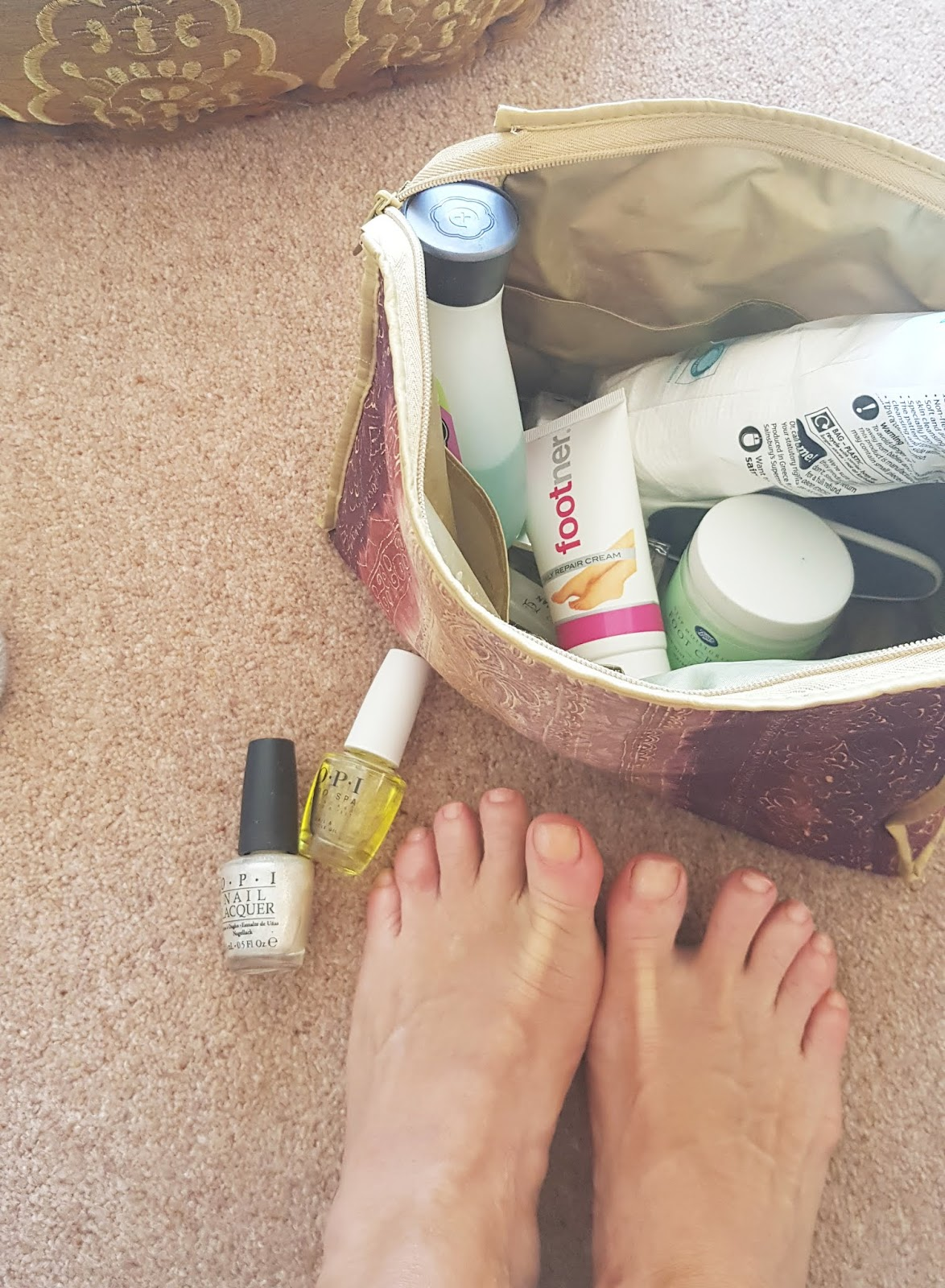A home pedicure during lockdown: various potions and lotions and pampered feet.