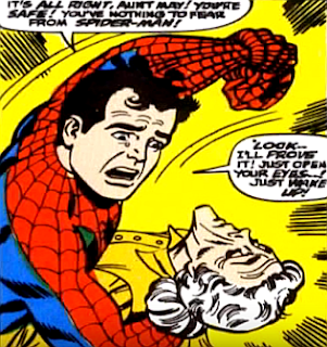 Amazing Spider-Man #54, john romita, peter parker tears off his spider-man mask as he holds aunt may who's been injured in his with with doctor octopous