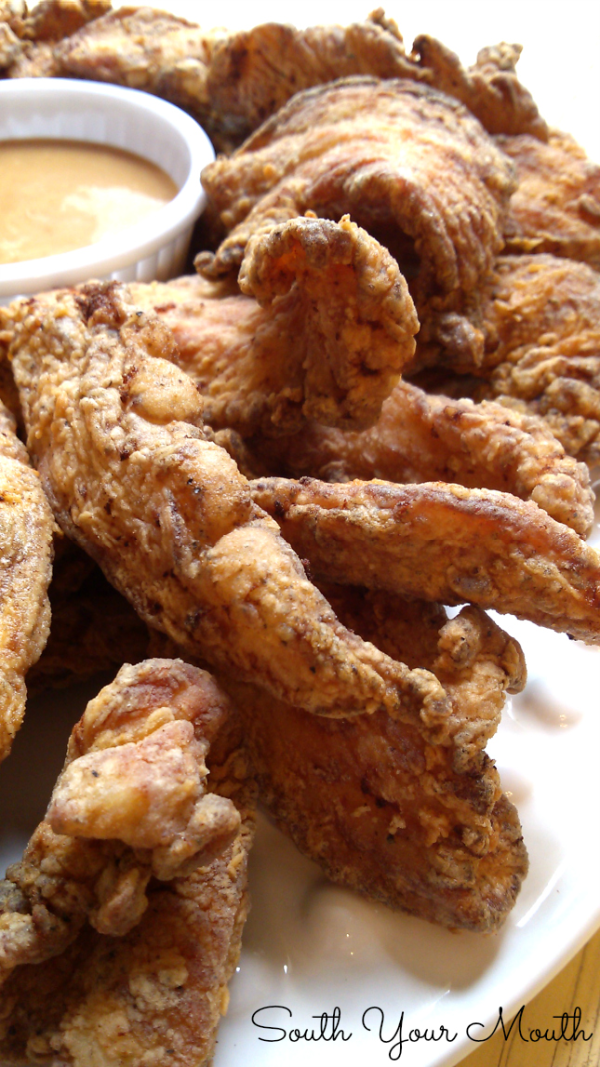 Calabash Chicken! A simple recipe for lightly breaded Calabash chicken strips fried crispy and light.