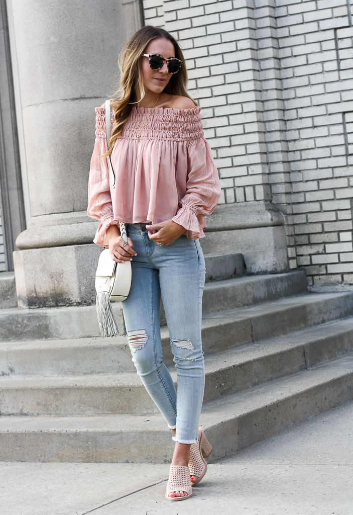 Pink off the shoulder top and distressed denim