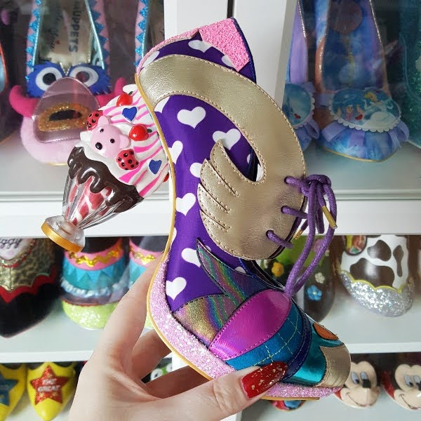 holding ice cream sundae heeled shoe in hand with shoe room in background