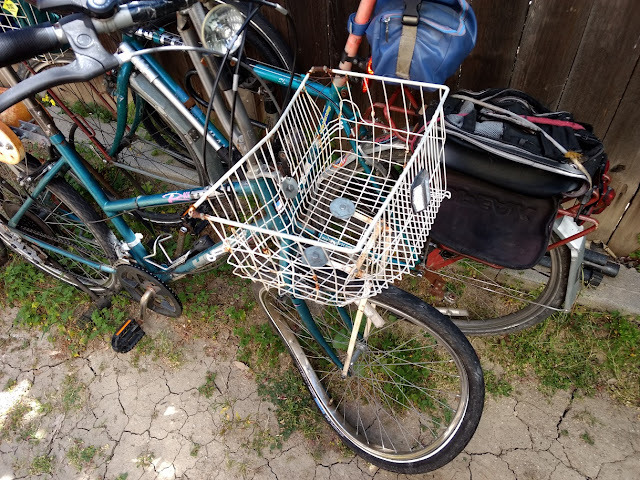 bicycle basket and wheel after car crash
