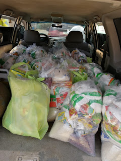 A vehicle with food bags being given away in Honduras
