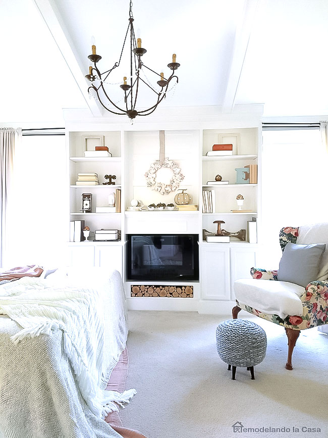 build-ins with fireplace, wingback chair, cozy bed,