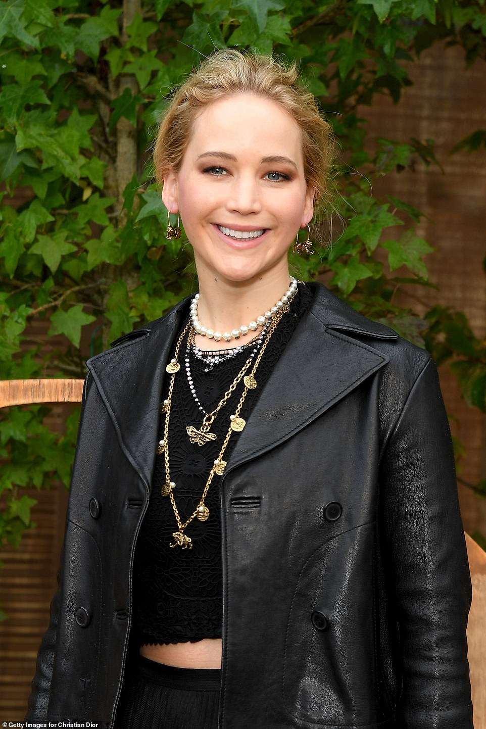 Jennifer Lawrence showed off her washboard abs in a black knitted crop top