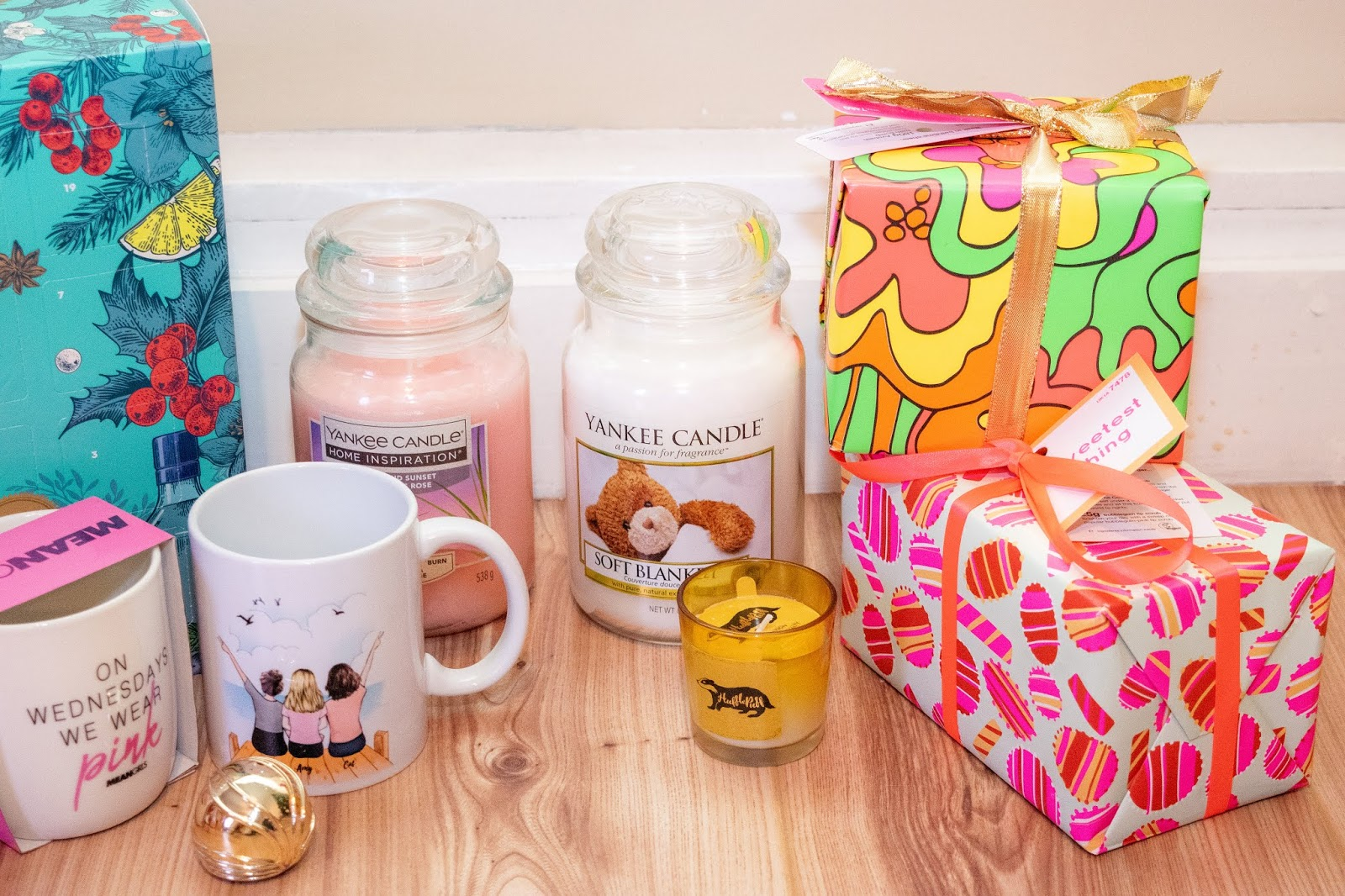 Food and home gifts together: lush gift sets, mugs, candles.
