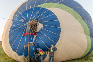 Cramer Imaging's fine art photograph of a hot air balloon being inflated with Snoopy on the top