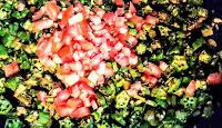 Chopped tomatoes over bhindi for bhindi ki sabji bhindi fry recipe