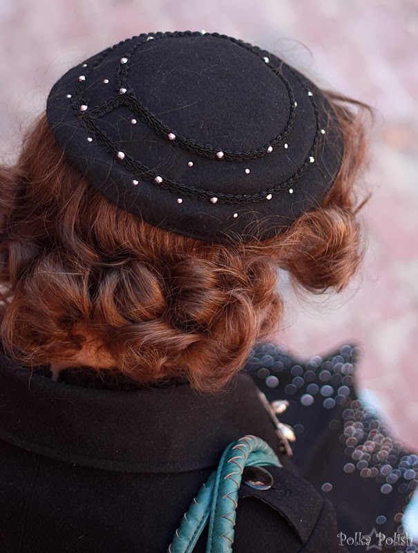 A vintage sparkly hat matches perfectly with a modern sparkly coat