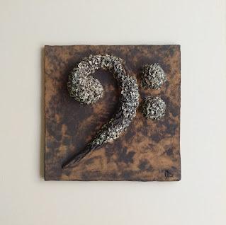 Cuadro de cerámica clave de fa