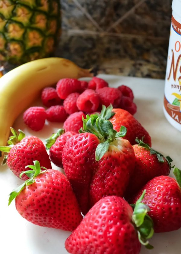 Strawberries Raspberries Banana and yogurt to make smoothie recipe.