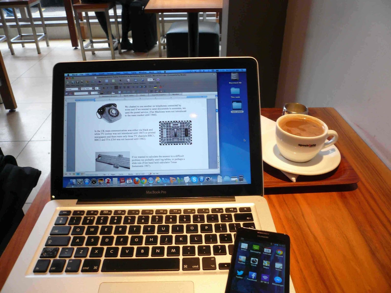 Picture of Laptop and smartphone in London Cafe [[slnc 1000]]