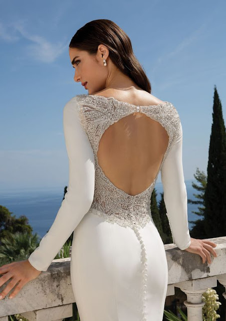 K'Mich Weddings - wedding planning - wedding dresses - crepe long sleeve fit and flare white dress open back - justin alexander