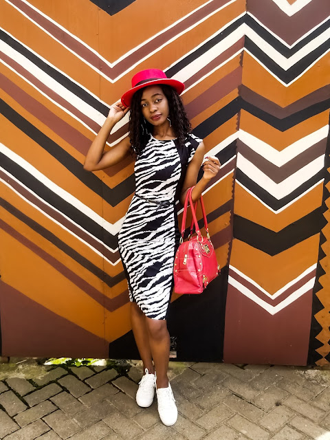 How To Wear A Zebra Print Dress With White Sneakers