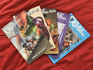 Five Rat Queens books spread against a red background