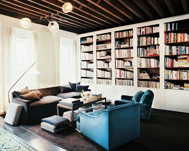 Library of books  on shelves in home of Amanda Peet in Vogue