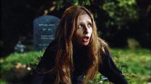 screencapture of Buffy rising from her grave after resurrection