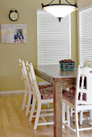 Wooden dining table and white chairs for farmhouse dining room