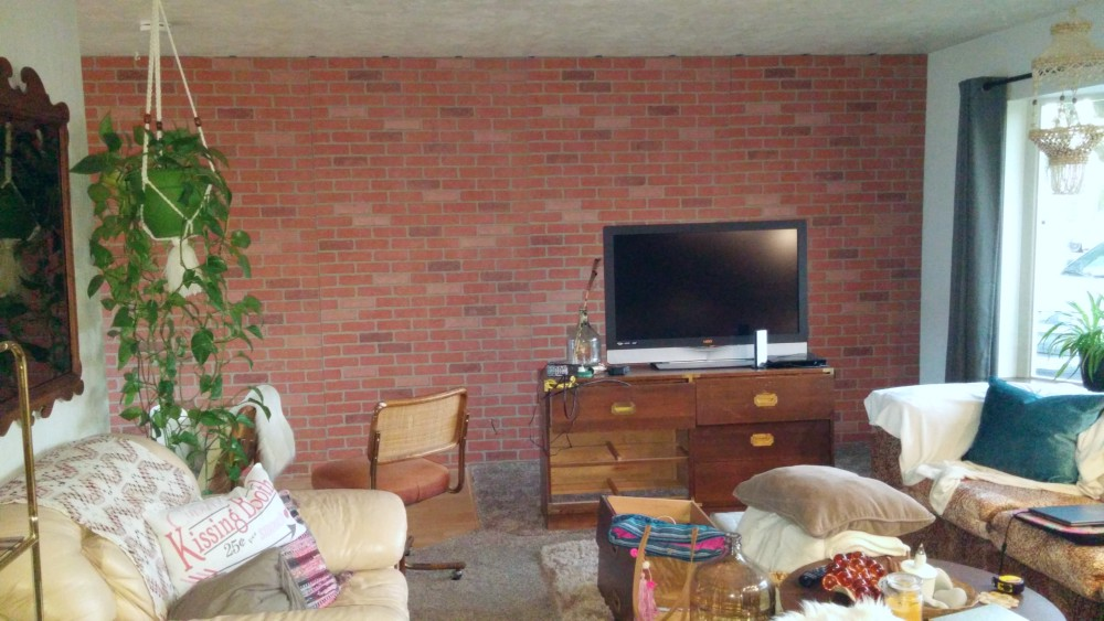 Living room wall after the brick was installed