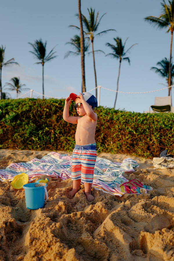 Toddler taking in the scene at Poipu Beach, Kiahuna Plantation, Kauai