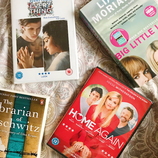 flatlay - home again dvd, everything everything dvd, big little lies book, the librarian of auschwitz book