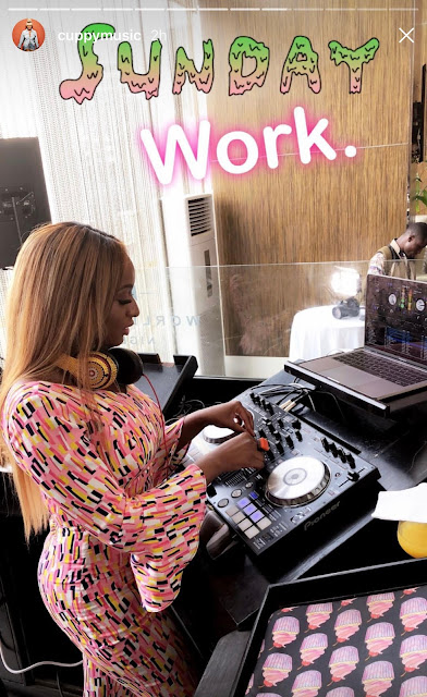 Billionaire daughter, Dj Cuppy poses in jumpsuit beside her bullet proof G-Wagon