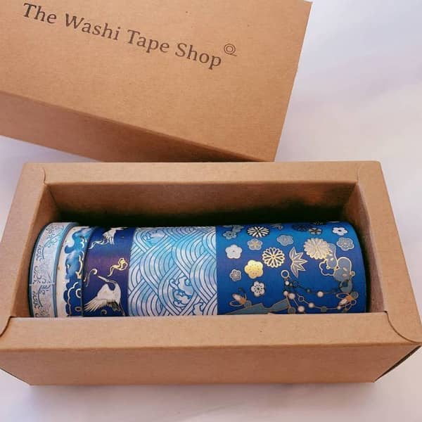 boxed set of gilded washi tapes in varying widths and shades of blue