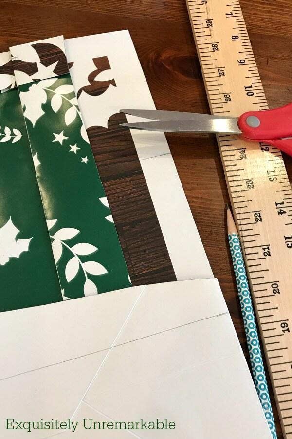 DIY Supplies for gift bag sign including bag, scissors, yard stick