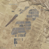 The Longyangxia Dam Solar Park captured by Landsat 8 in April 2013 and again in January 2017. (Credit: NASA Earth Observatory) Click to Enlarge.