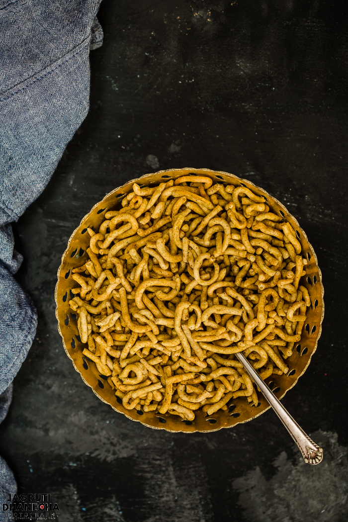 Ratlami Sev, spicy, tangy and crispy noodles prepared with gram flour ( besan ) and aromatic spice powders.  This deep-fried snack is easy to prepare and one of the most popular snacks consumed by Indians all over the world and especially given more importance on Indian festivals such as Diwali.