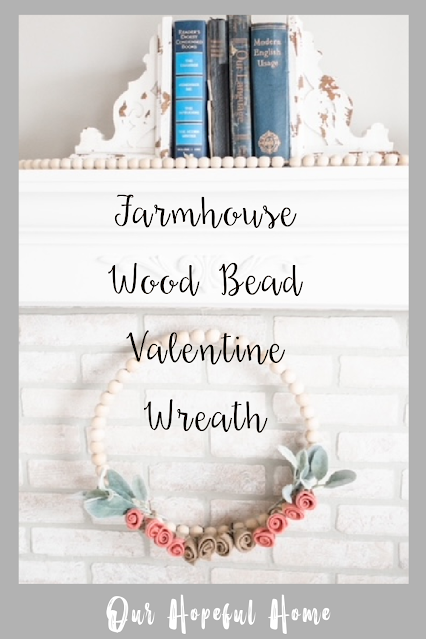 fireplace white brick pink flower wood bead wreath