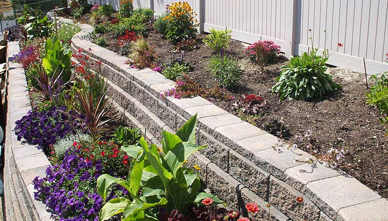 the allan block blog sloping yard solutions