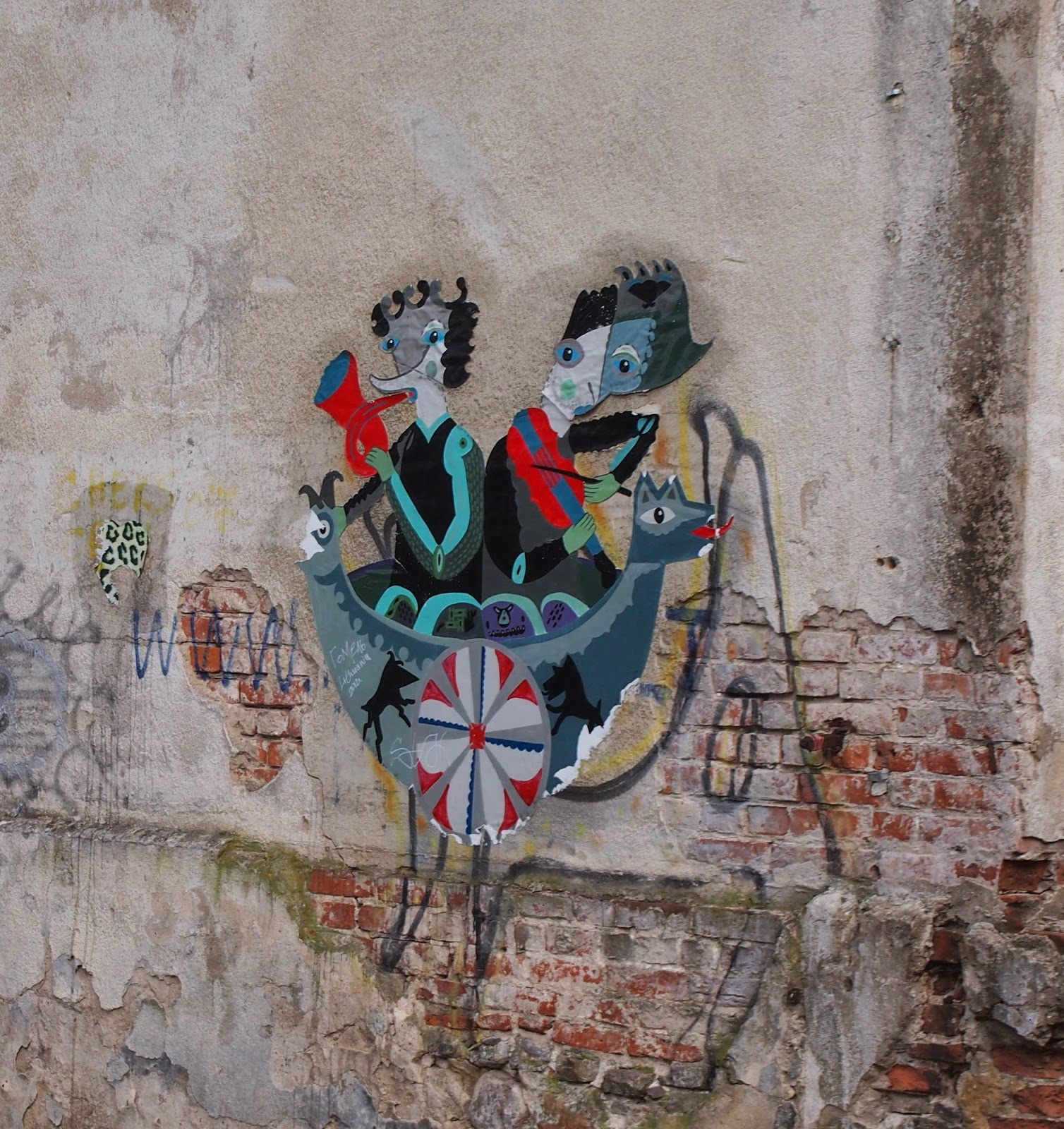 strange but cool street art on a dilapidated building in Kaunas, Lithuania