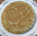 tortilla de habas baby y ajos tiernos