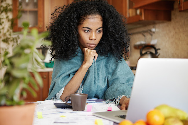 Image of Beautiful black woman sitting in front of her computer.