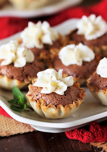 Chocolate Chess Pie Tartlets with Almond Whipped Cream Topping Image