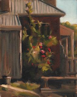 Landscape oil painting of rose bushes beside a building